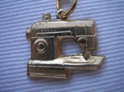 Image of sewing machine necklace