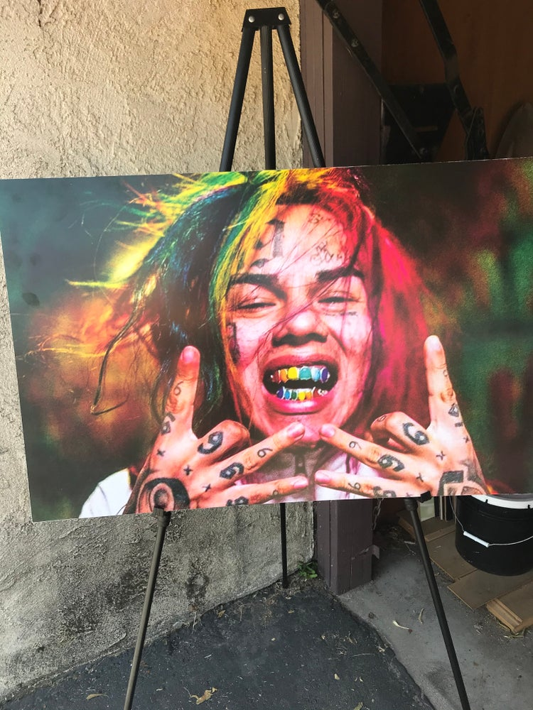 Image of 6ix9ine poster on wood