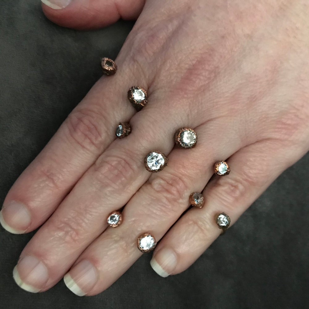 Image of ATLANTIC open front rings in cubic zirconia