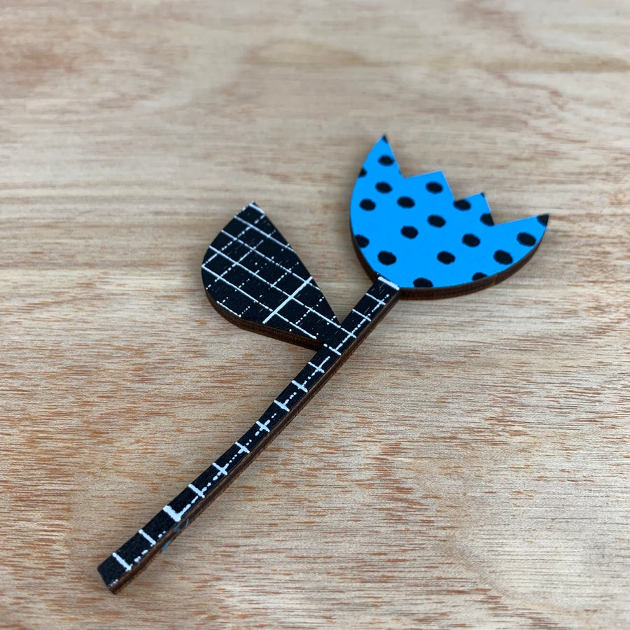 Image of Screen Printed Wooden Flower Brooch with Stand - Blue with Black Polka Dots and B&W Grid