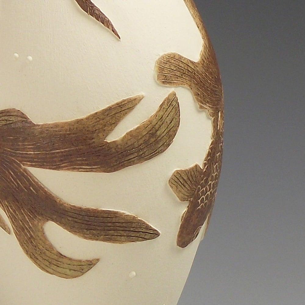 Long fantailed fancy fish ceramic sgraffito vessel