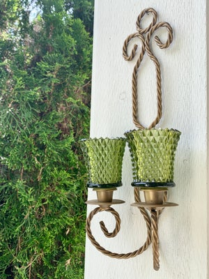 Image of A vintage metal gold brass hued double wall scone  paired with two votives.