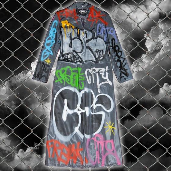 Image of metallic grey graffiti matrix trench coat