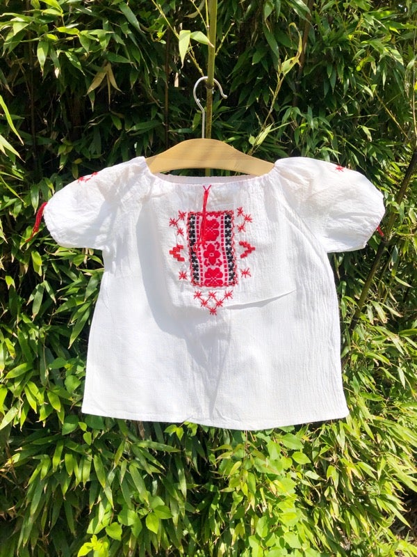 Image of Fine white cotton shirt with simple folky embroidery. Age 2yrs.