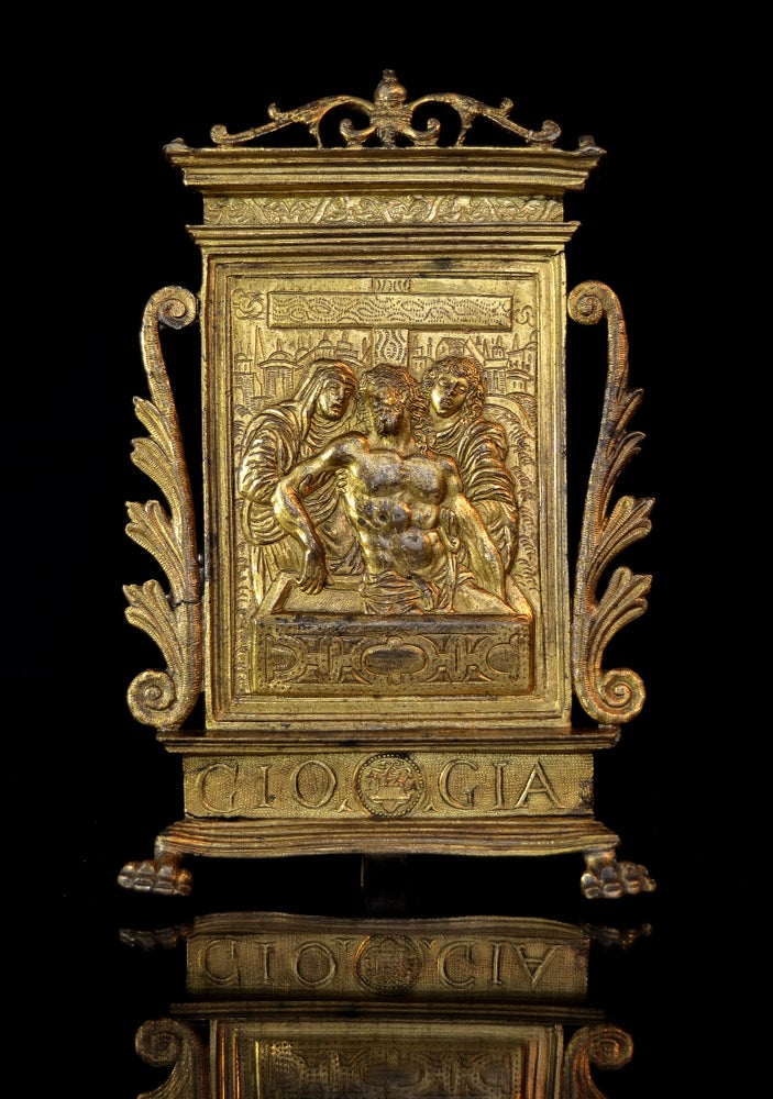 Image of An elaborate gilt bronze pax of Christ in the Tomb, dated 1571, after Moderno