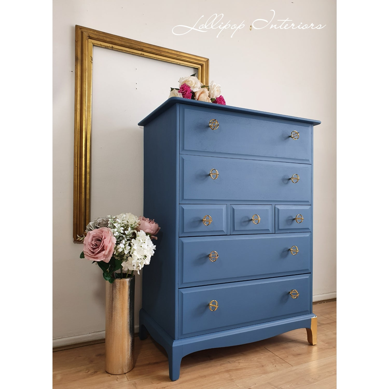 Image of Stag tallboy drawers in blue with gold handles
