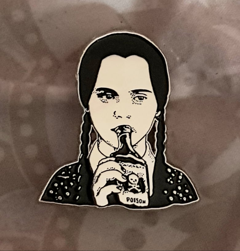 Image of Wednesday Addam's limited edition shaped enamel pin