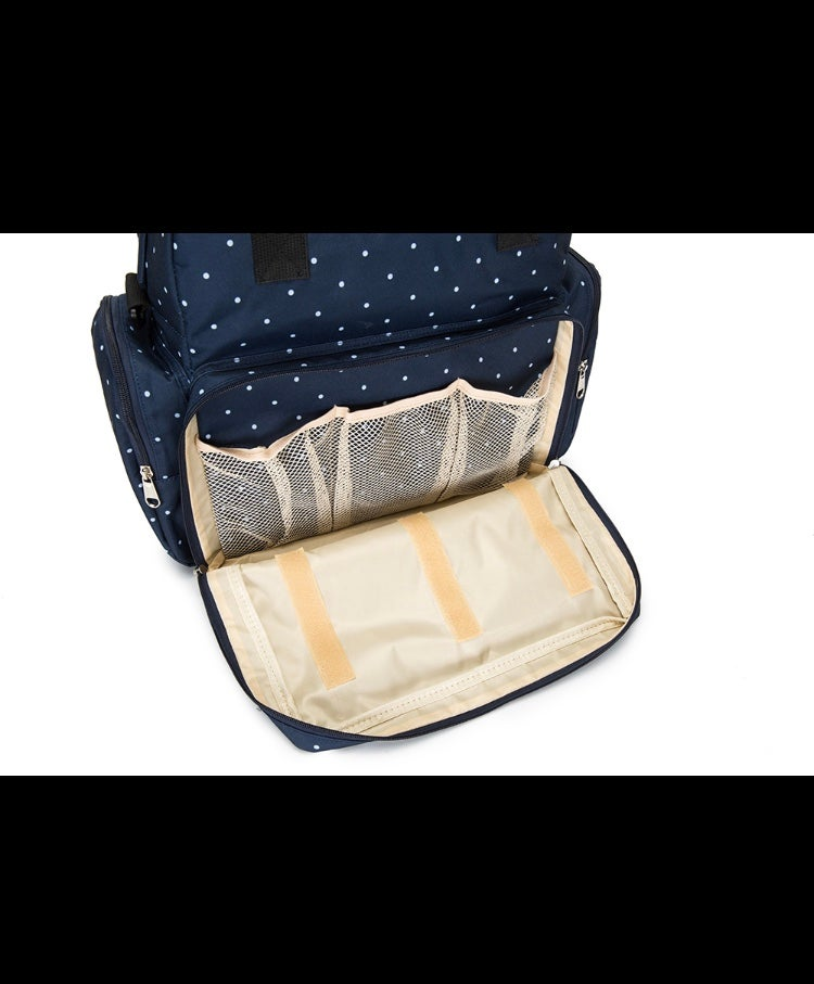 Diaper bag with attached changing mat