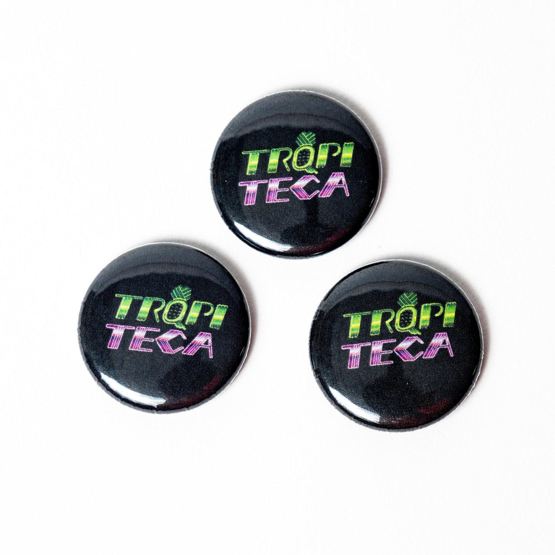 Image of TRQPITECA button