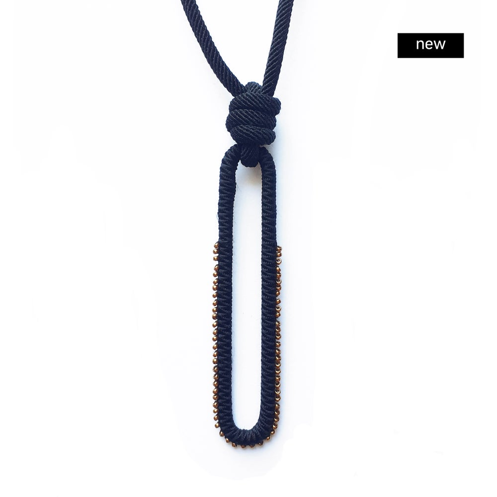 Image of pendant beaded necklace #1873, color 1B or 10B (limestone/bronze or carbon/bronze)