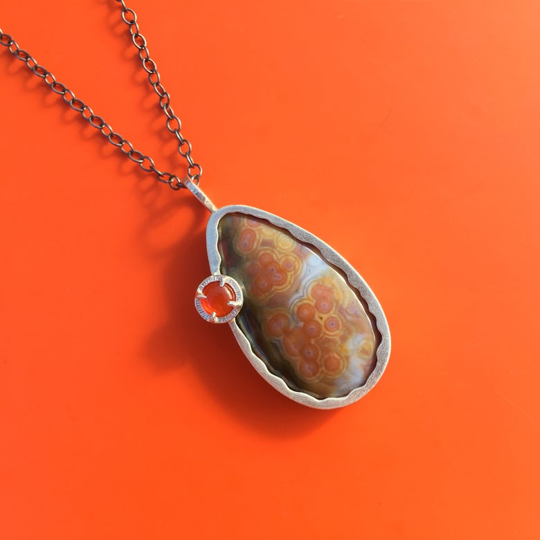 Image of ocean jasper eclipse pendant with carnelian