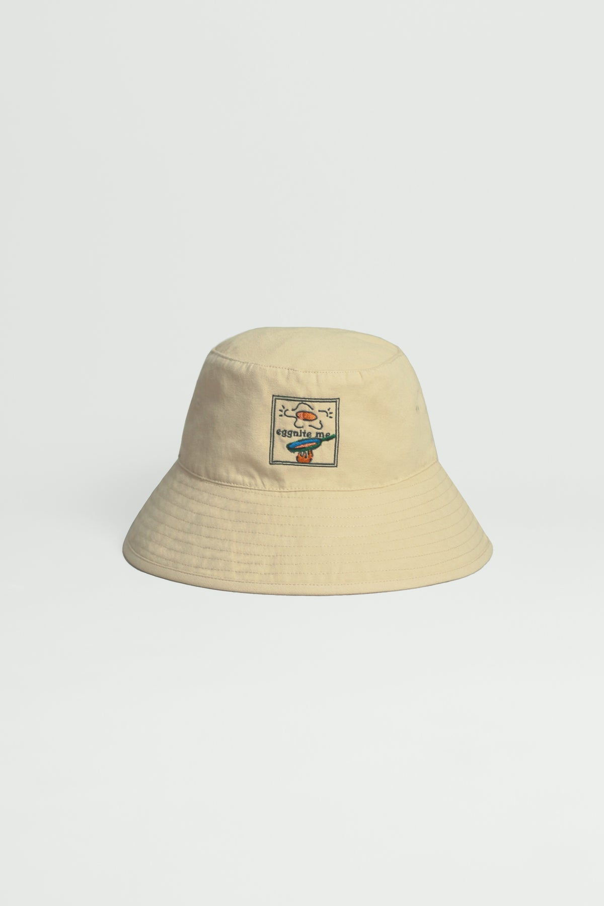 """Graphic Embroidery Tee - """"Eggnite Me"""" Bucket Hat"""