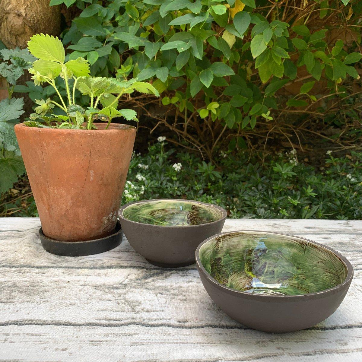 Black clay bowl, white slip & green glaze interior