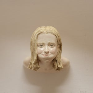 "HEADS ""TRATTIENE"" wall sculpture"