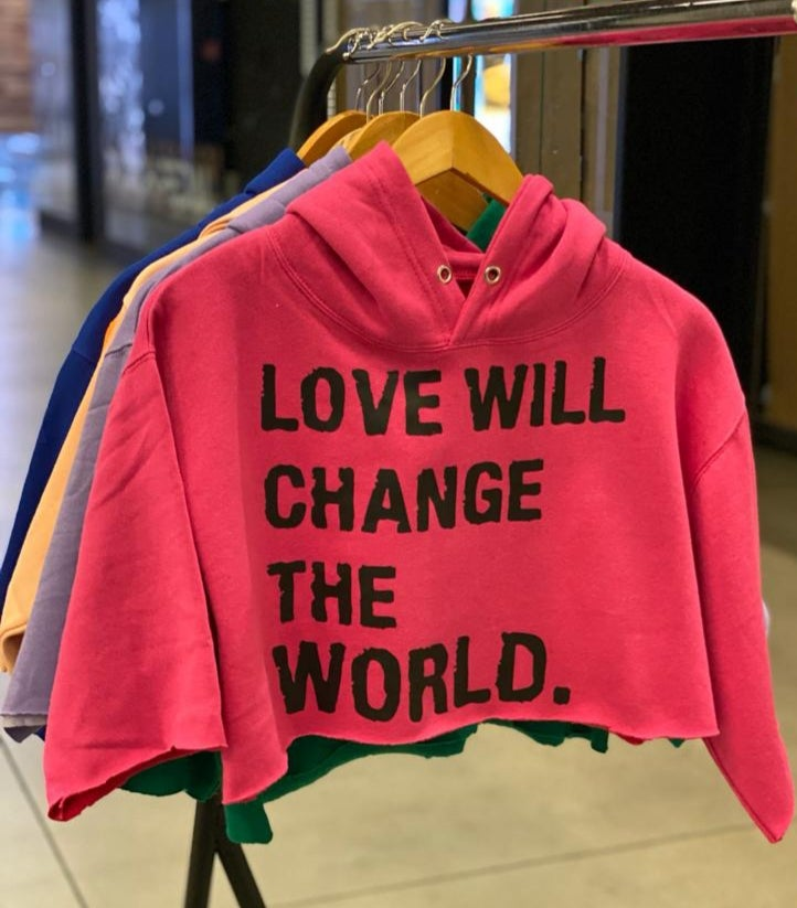 """Image of """"Love Will Change The World"""" Crop Top hoodie."""