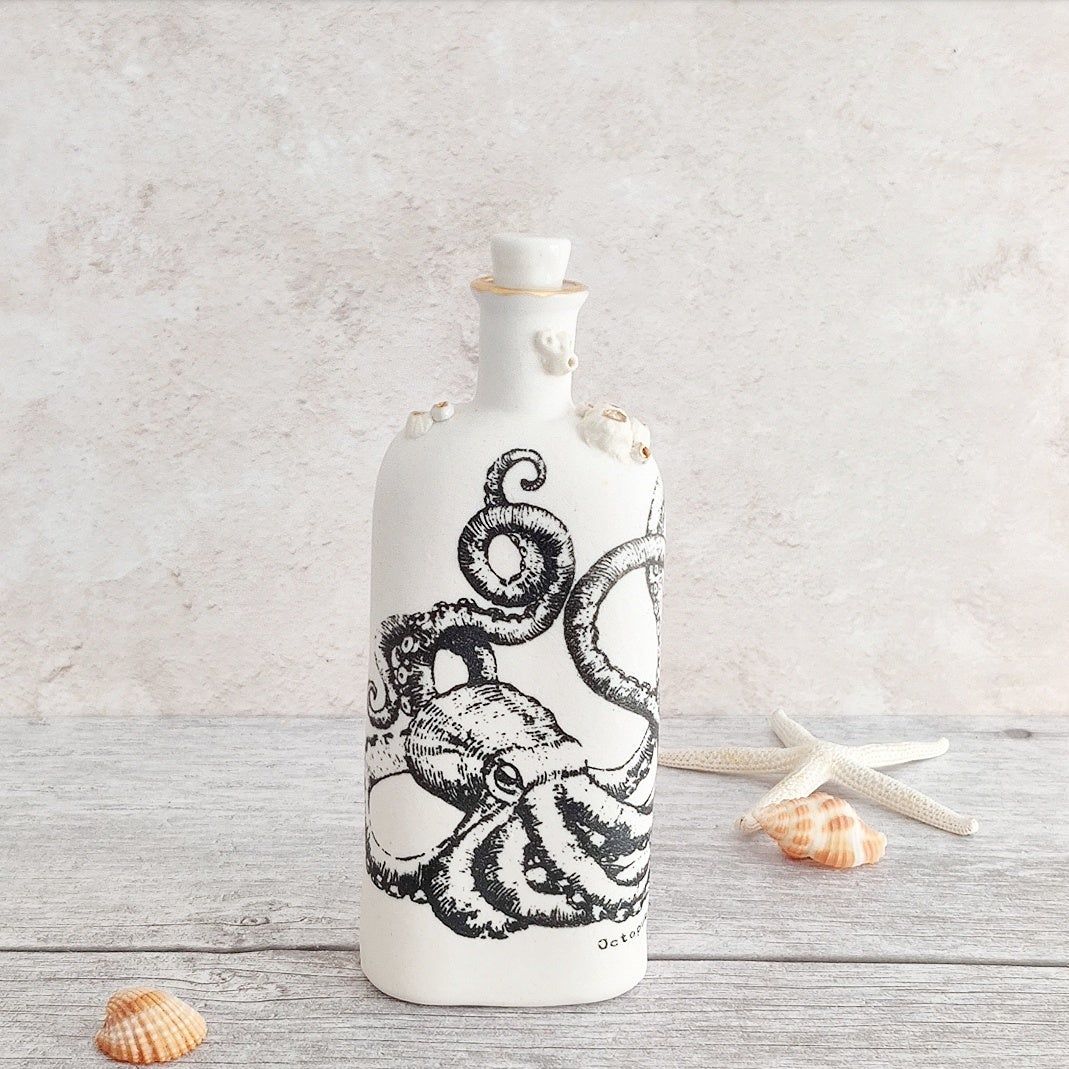 Porcelain 'boots' octopus bottle with barnacles