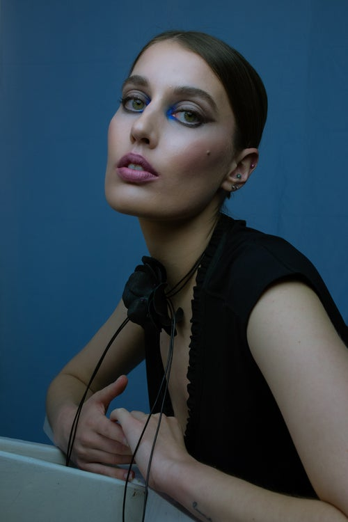 Image of Black leather flower necklace with pearls and leather strands