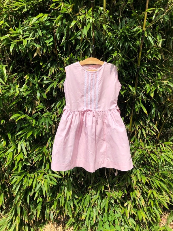 Image of Crisp cotton dress in pastel pink with stiff underskirt. Age 4-6yrs.