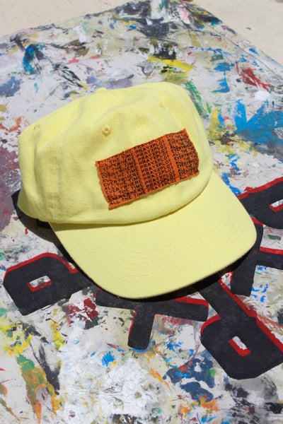 Image of e.w.a.t. hat in yellow
