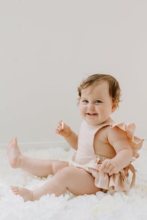 Image of Linen ruffle romper in peachy blush