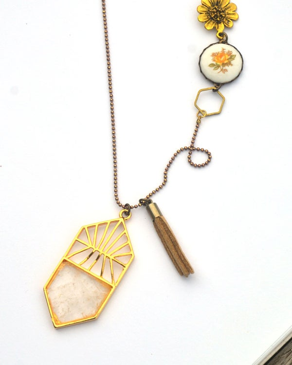 Image of asymetrical crystal and vintage linked assemblage