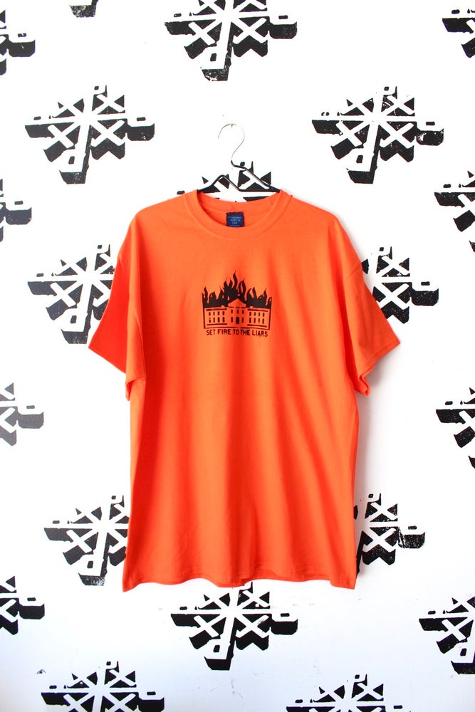 Image of set fire to the liars tee in orange