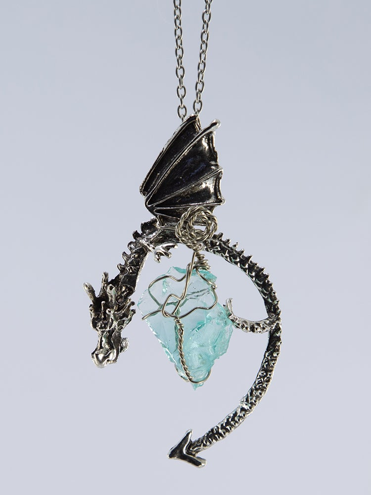 Image of Dragon Pendant with Aura Quartz wrapped with silver and silver spiral wrap.