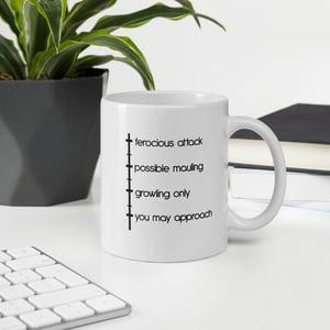 Image of bear, with coffee mug