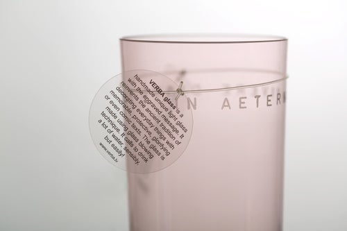 Image of VERBA pink water glass with inscription in Latin or Ancient Greek