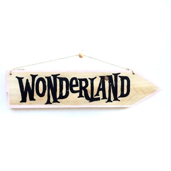 Image of Cartel flecha Wonderland