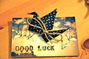 "Image of ""Good Luck"" card with Crane brooch"