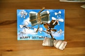 "Image of ""Happy Birthday"" card with Bow brooch"
