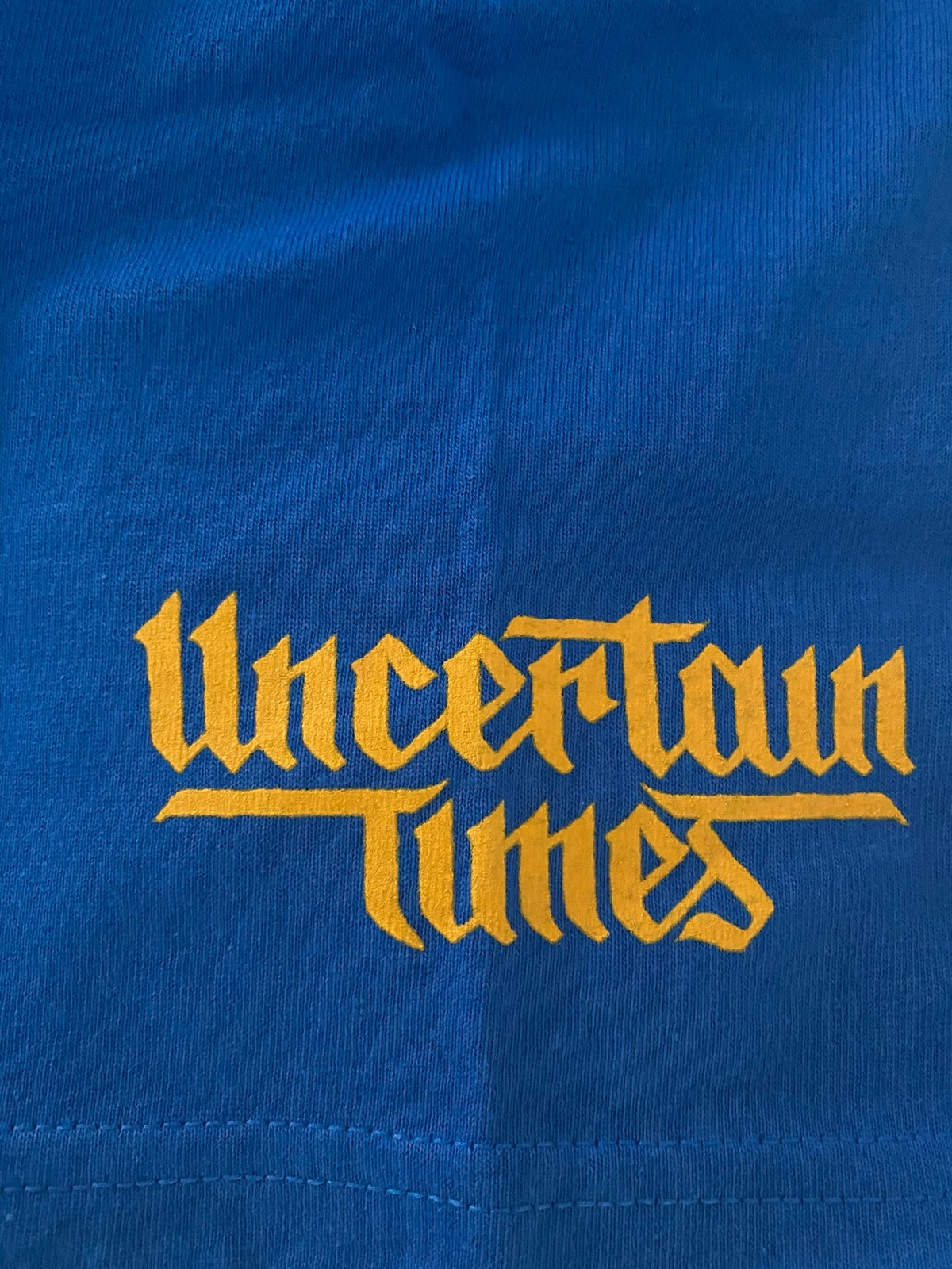 Image of UNCERTAIN TIMES CHARITY TEE - ROYAL BLUE