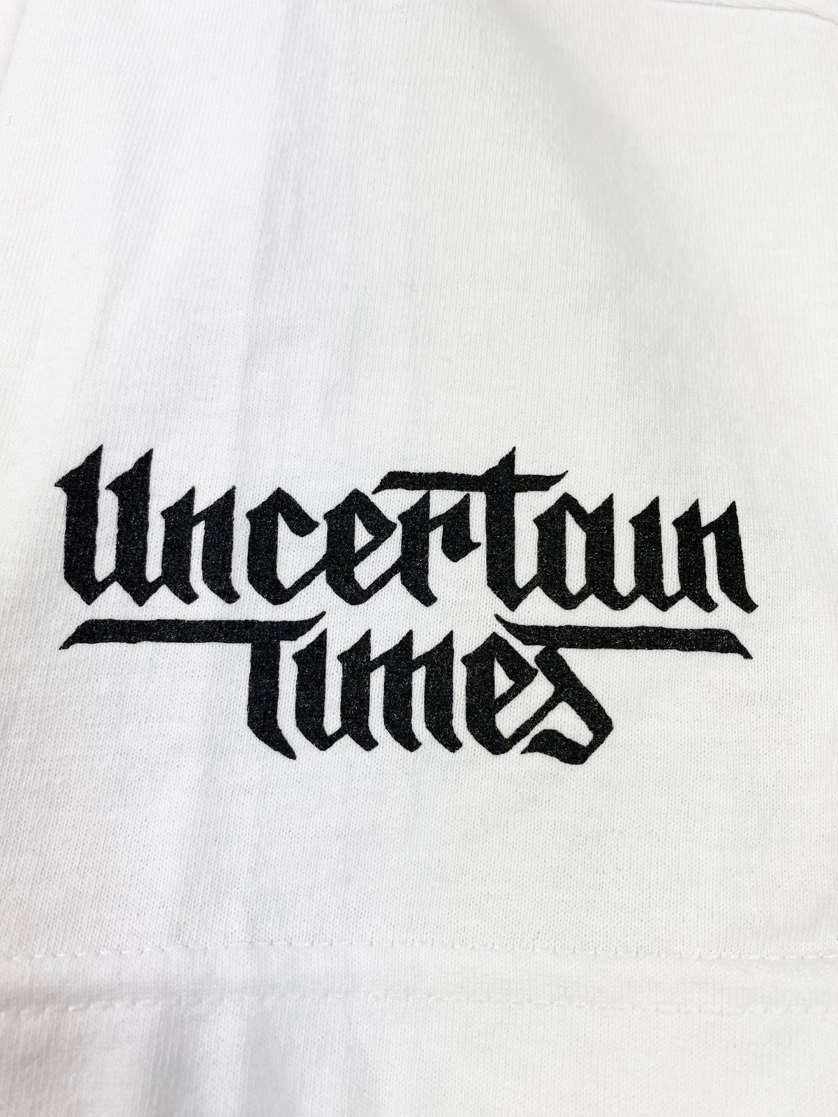 Image of UNCERTAIN TIMES CHARITY TEE - WHITE