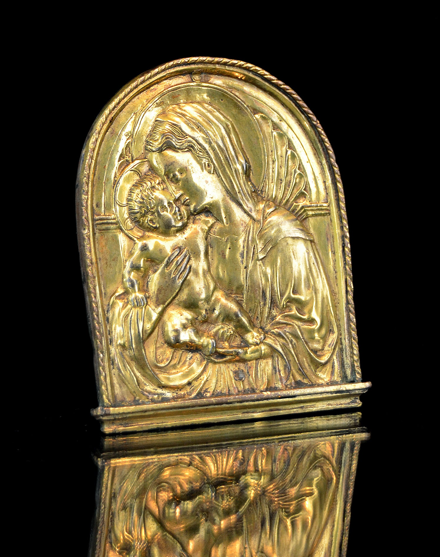 Image of An important Florentine gilt bronze pax of the Virgin and Child, after Donatello