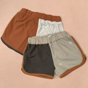 Image of Split Coloured Shorts. Green / Beige  (WAS £18)