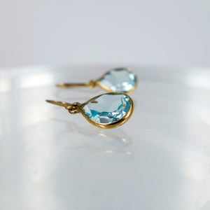 Image of E1794 - 9ct yellow gold pear shaped drops with Icey blue Topaz