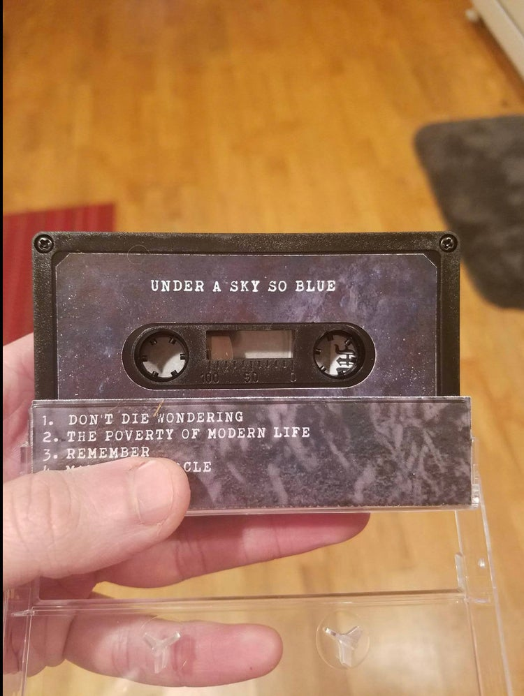 UNDER A SKY SO BLUE 'The Spectacle Provides' cassette