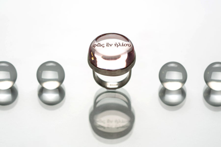 Image of silver ring with rose plexiglass φῶς ἓν ἡλίου