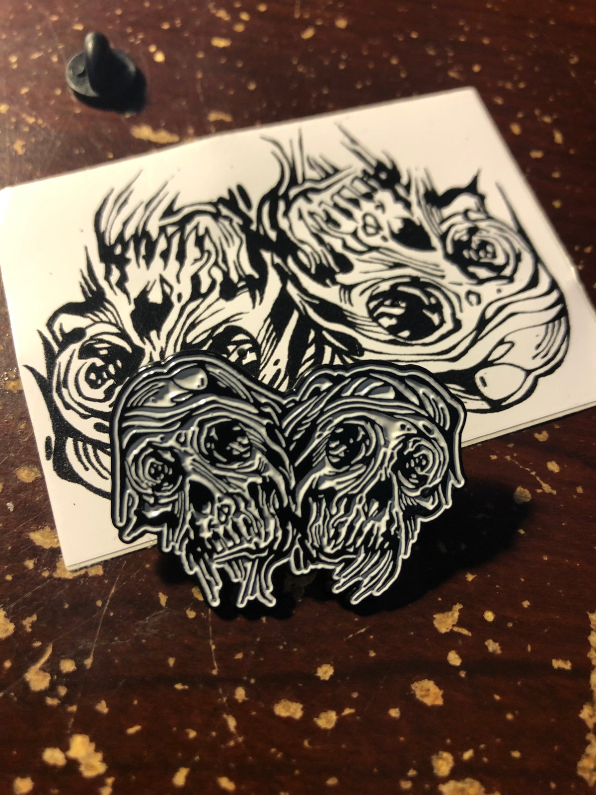 Image of Two skulls enamel pin