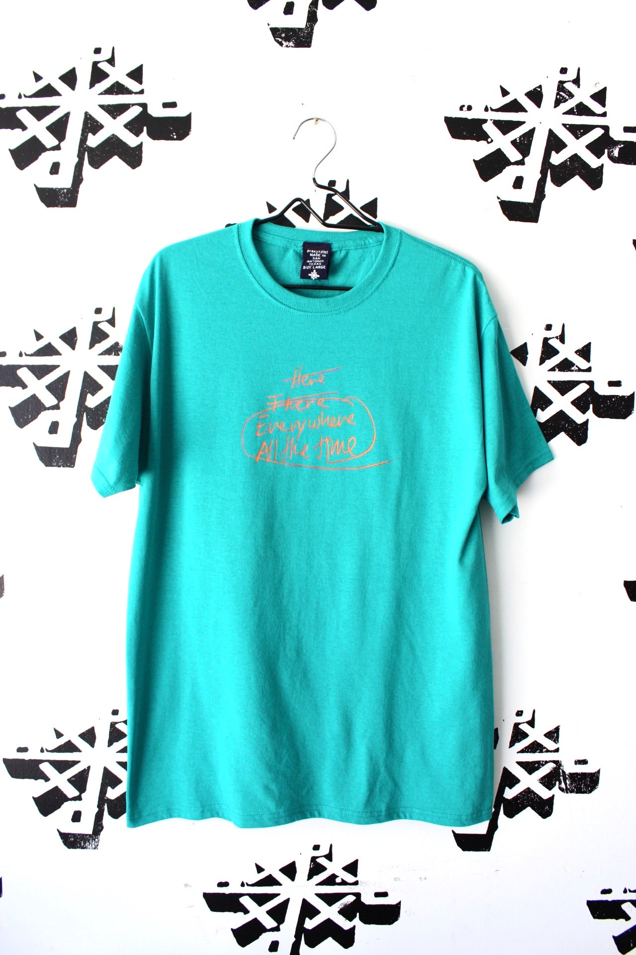 Image of that one tee in teal