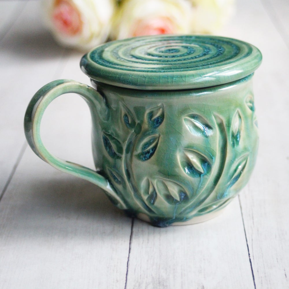 Image of Shimmering Green Pottery Mug with Warming Lid, Hand Carved Coffee Cup, Made in USA