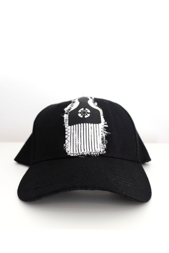 Image of picked out baseball cap in black