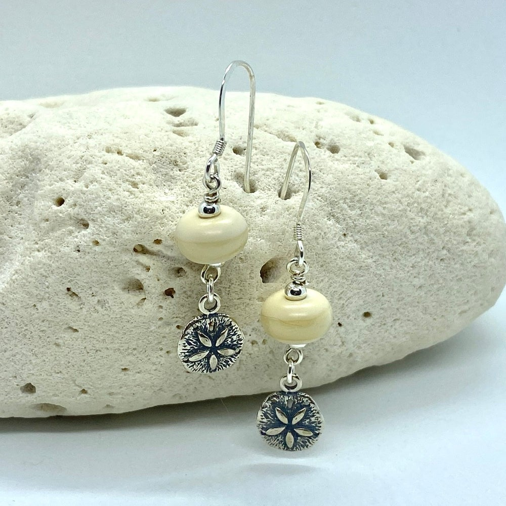 Image of Ivory Sand Dollar Dangle Earrings