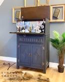 Image 1 of Solid oak drinks cabinet in dark grey & gold.