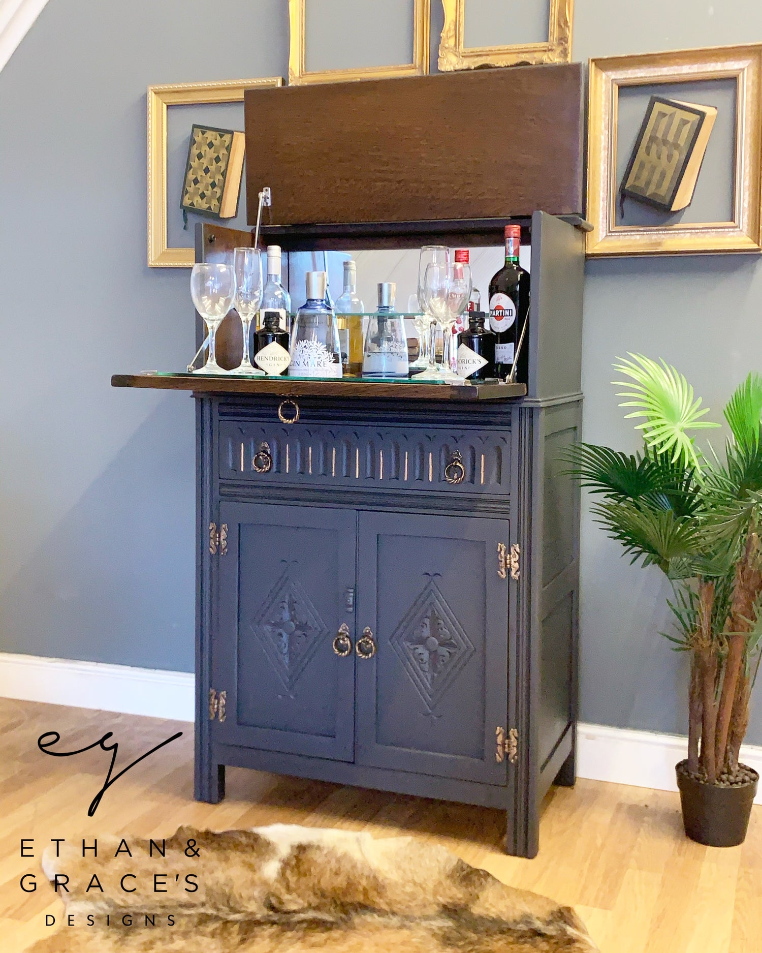 Image of Solid oak drinks cabinet in dark grey & gold.