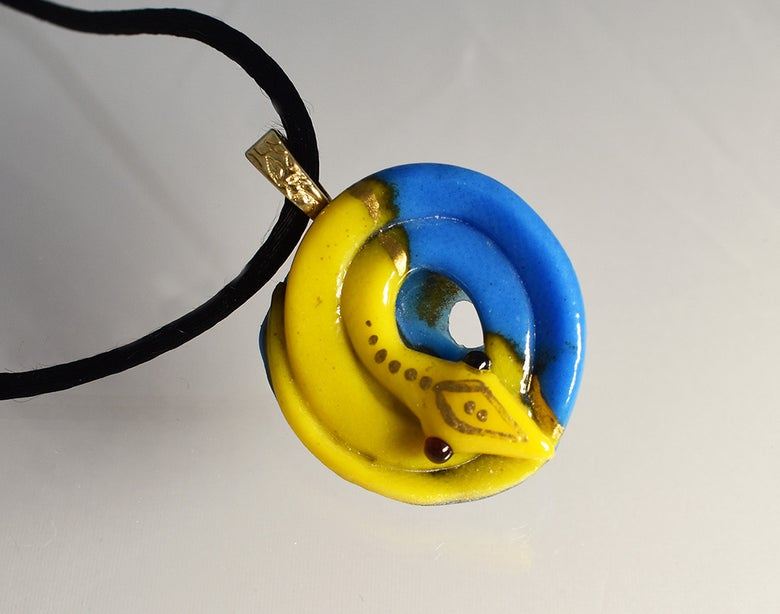 Image of **Fused Glass Pendant Coiled Snake Blue and Yellow
