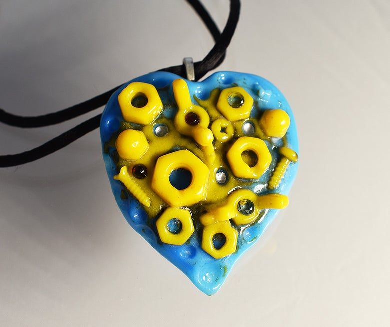 Image of **Cast Glass Pendant The Nuts and Bolts of Love Yellow and Blue