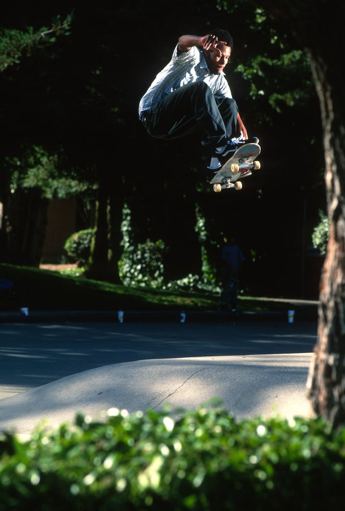 Ray Barbee, tuck knee front side air, Benicia by Tobin Yelland