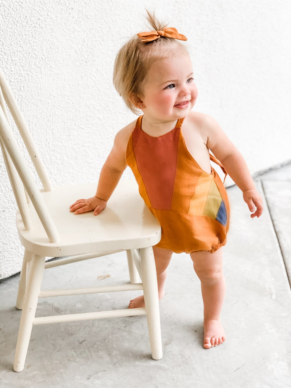 Image of Rust Rainbow Romper